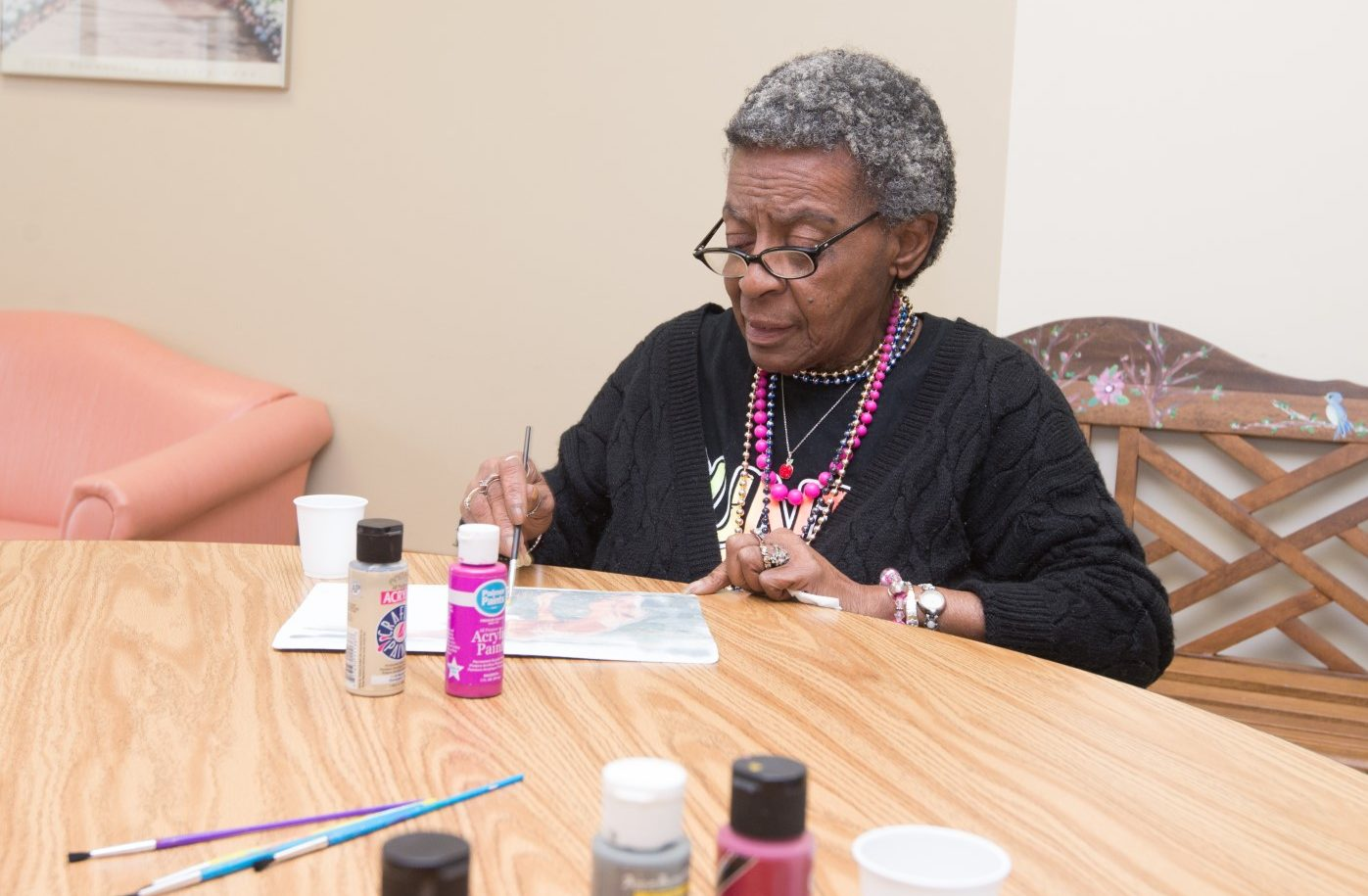 Elderly woman painting during Senior Activities