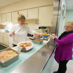 senior day services staff serving food