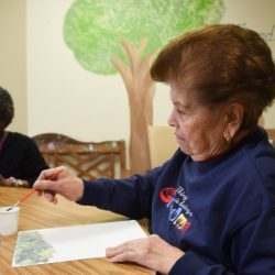 elderly woman painting at Senior Day Services