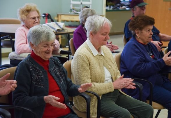 elderly women clapping during senior activites